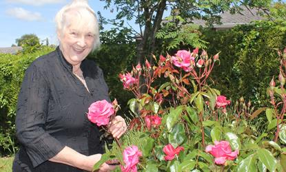 Residents - Maria with roses.jpg